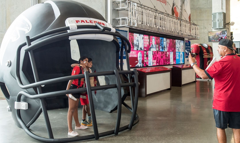 The larger-than-life Atlanta Falcons helmet at the American Family Insurance Fan Village provides Instagram-worthy spots for fans to share their experience.