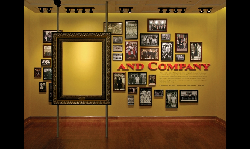 """Heritage displays emphasize the """"and Company"""" part of Eli Lilly's name. To visualize their place on the Lilly team, visitors place themselves inside the picture frame."""