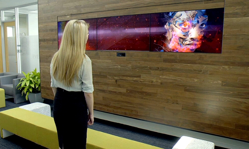 Array's gesture-based video wall at the Adobe headquarters helps inspire collaboration, innovation, and creativity among employees. Like Adobe's products, the installation makes creative expression possible and reinforces how Adobe is changing the world through digital experiences.