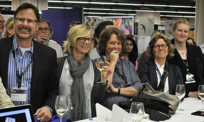 Conference-goers enjoy the Auction for Excellence. (Photo: Robin Lopez)