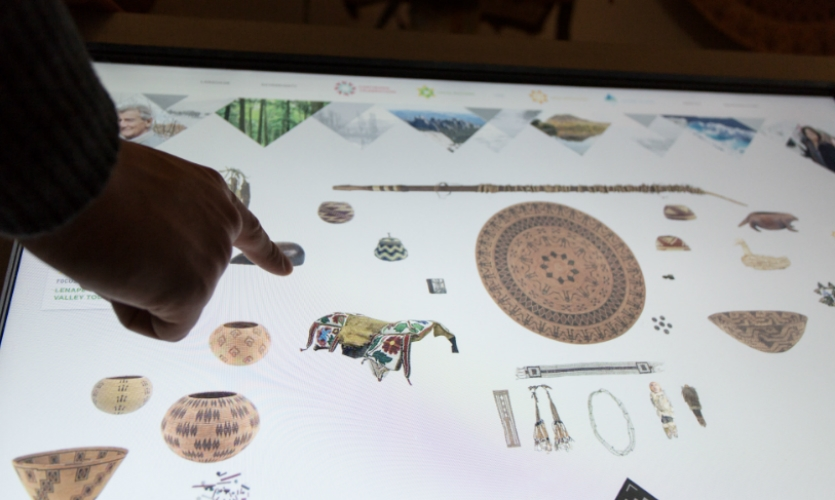 A series of interactive object screens invite visitors to explore the museum's rich collections.