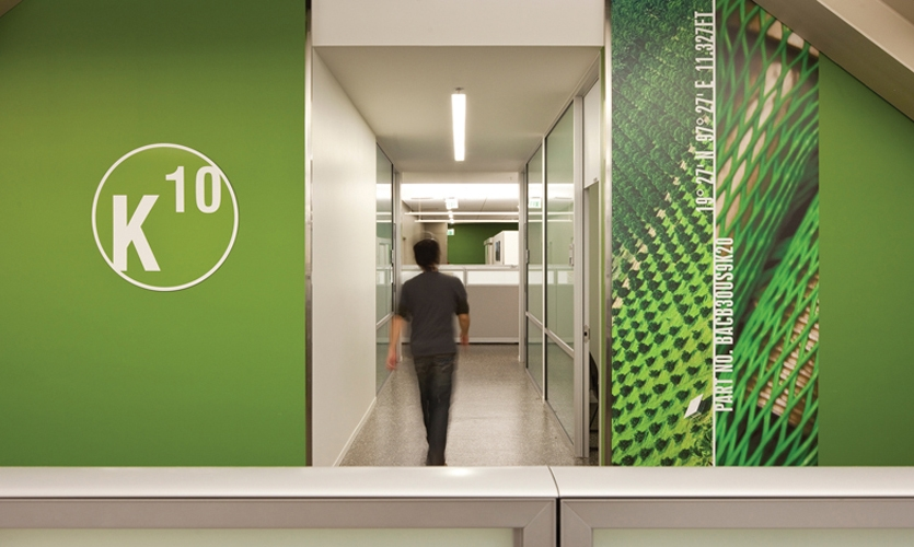 The bright color scheme and grid-based signage extends to office spaces.