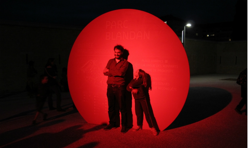 Lighting designers On bathed the largest of the circles in red light, inviting visitors to engage with them.