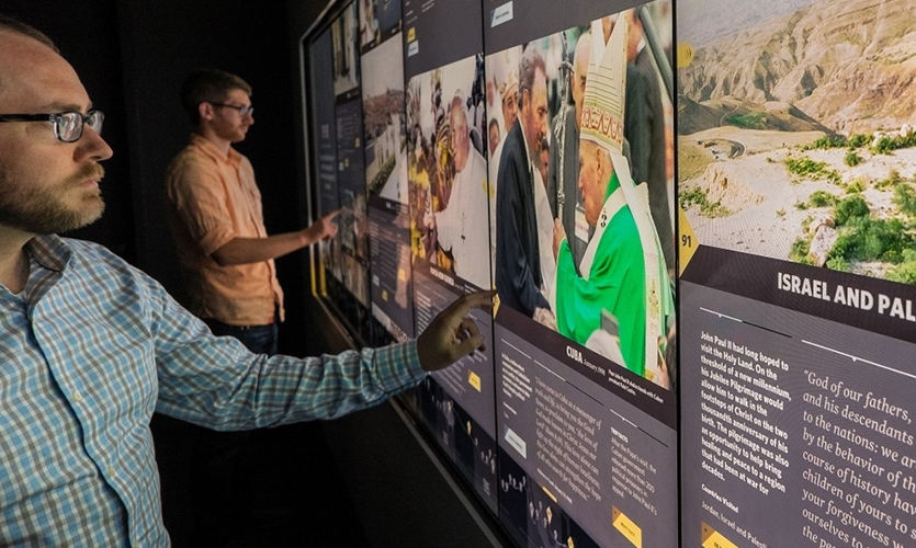 The 14-foot-long World Travels touchscreen invites visitors to explore Saint John Paul II's 104 global trips, which are brought to life by powerful video clips and photographs.