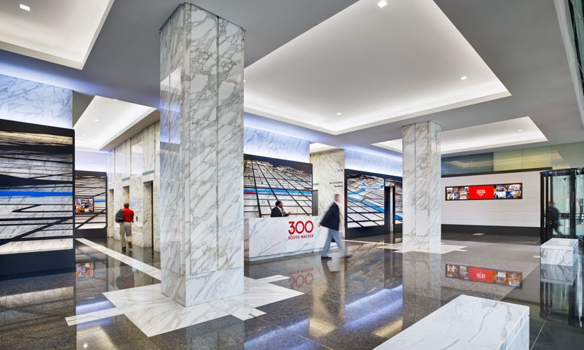 The lobby is punctuated with digital displays of custom, locally relevant, auto-updating content that visualizes a feed of local happenings and data.