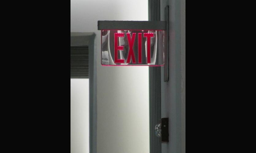 Fig. 12. The ubiquitous exit sign shows how visual cues (material and surface choices, legibility, etc.) can enhance accessibility.