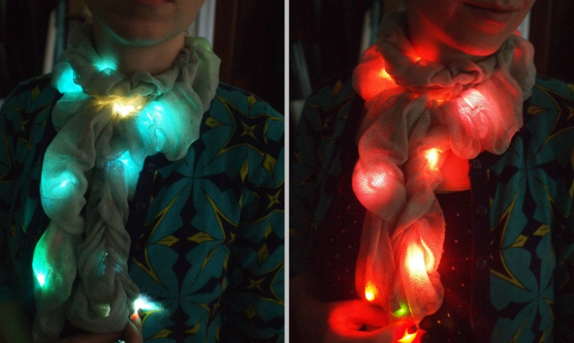 The chameleon scarf can match any outfit. It uses Adafruit's FLORA color sensor and 12 color-changing LED pixels diffused by ruffly knit fabric.