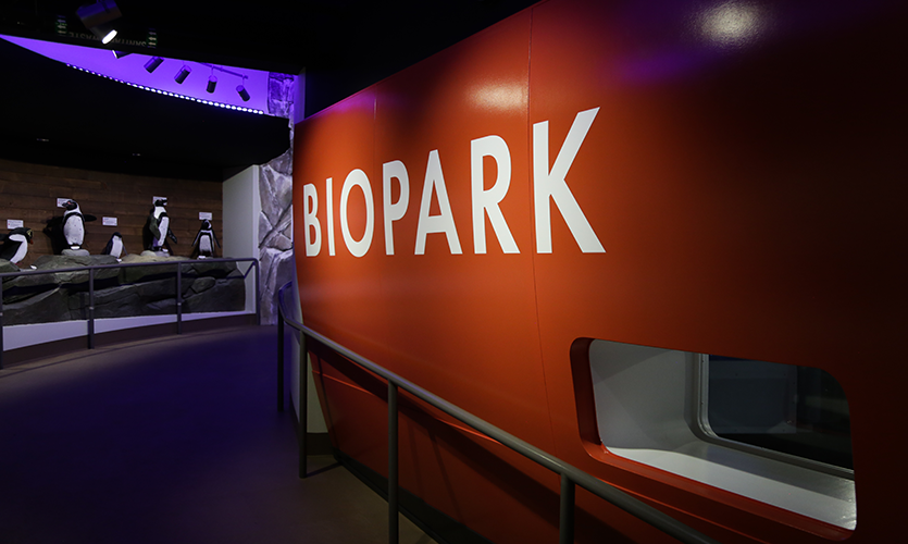 "Interpretive signage introduces visitors to the journey, as they board the research vessel ""RV BioPark,"""