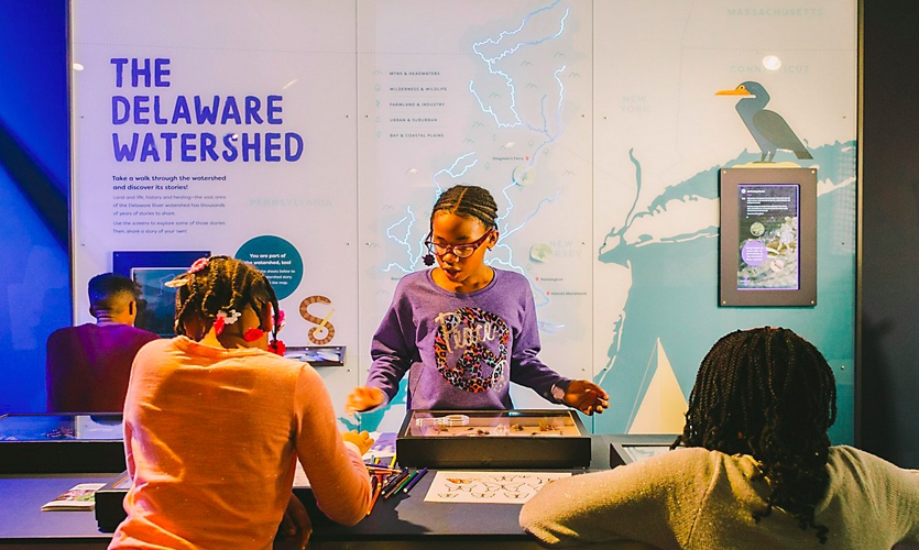 "The watershed map is a scale map of the Delaware Watershed with embedded lighting, and touchscreens that provide content ""lenses"" on the history and science of the area."