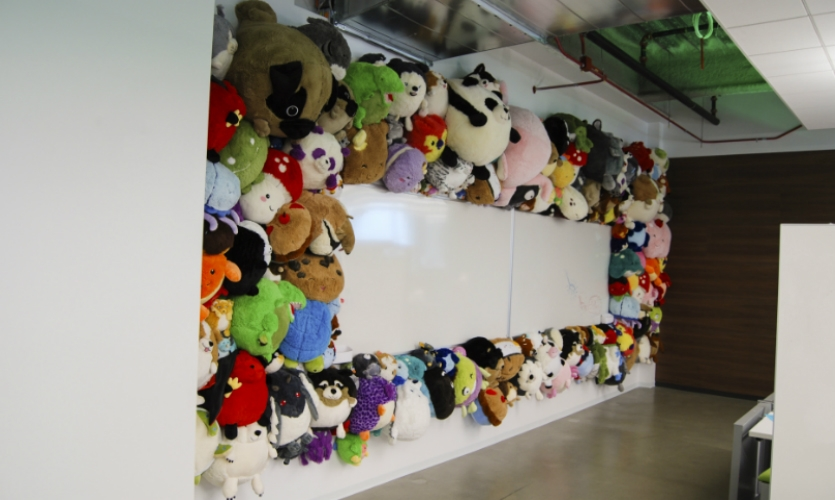 """Many employees have stuffed animals on their desks, so they love the wall of """"squishables."""""""