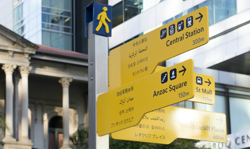 Providing multilingual messaging on the signs' limited real estate was a design challenge.