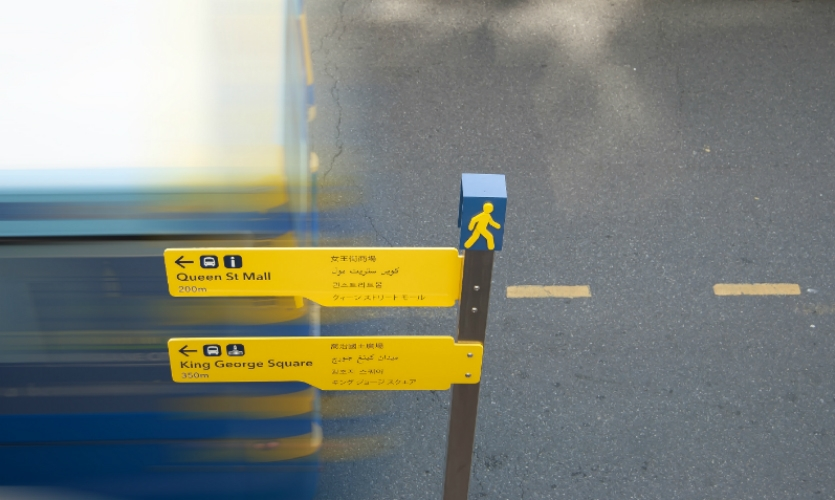 """Harlequin capped the signs with a """"walking man"""" logo."""