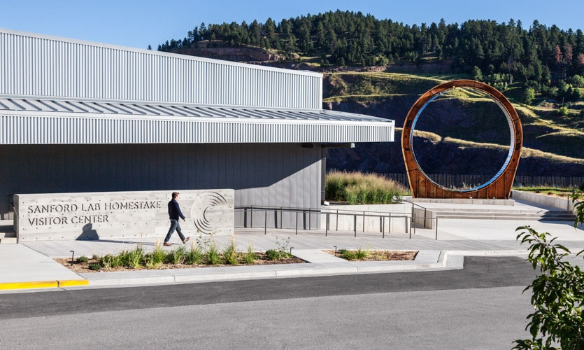 The contemporary architecture of the Center includes a form-cast concrete main sign, and a sculptural tribute to Dr. Ray Davis, who won the Nobel Prize for Physics as a result of his work at the mine.