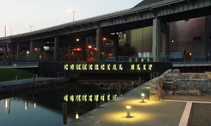 Typography for the site's primary identification was inspired by an 1800s broadside advertising passenger traffic on the canal. 4-ft.-high, LED-lit aluminum can letters spell out the harbor's historical name.
