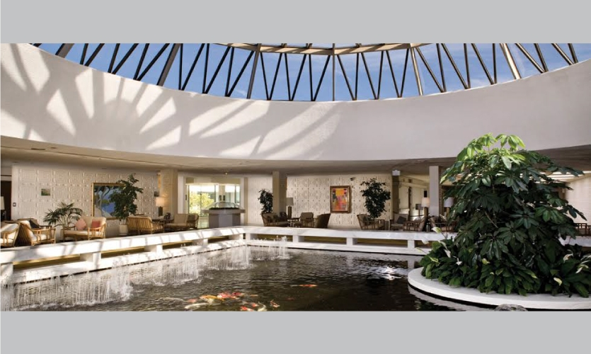 The lobby of the Community Hospital of Monterey Peninsula is uniquely designed with a large skylight dome and central koi pond.