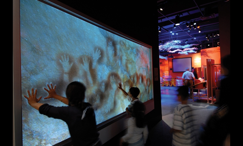 Handprints were man's earliest form of communication. Liberty recreated the gesture in a high-tech way, allowing visitors to leave their own prints behind on a projected cave wall. Cameras behind the wall take pictures of their hands and sophisticated image recognition software translates the images into negative prints.