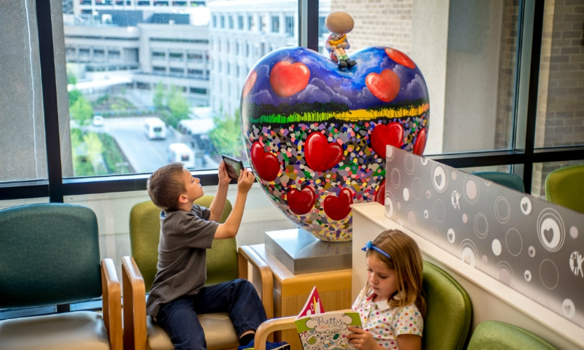 In CCHMC's Heart Institute waiting room, a hand-painted sculpture by renowned artist Mackenzie Thorpe symbolizes love and represents patients' strength and courage.