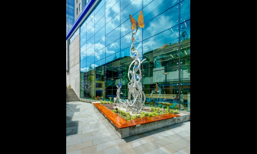 A sculpture in the garden outside Children's new Clinical Sciences Pavilion moves from free-flowing forms into a stylized DNA helix. (Architects: GBBN Architects. Artist: Brian Russell. Art Partner: Art Design Consultants)
