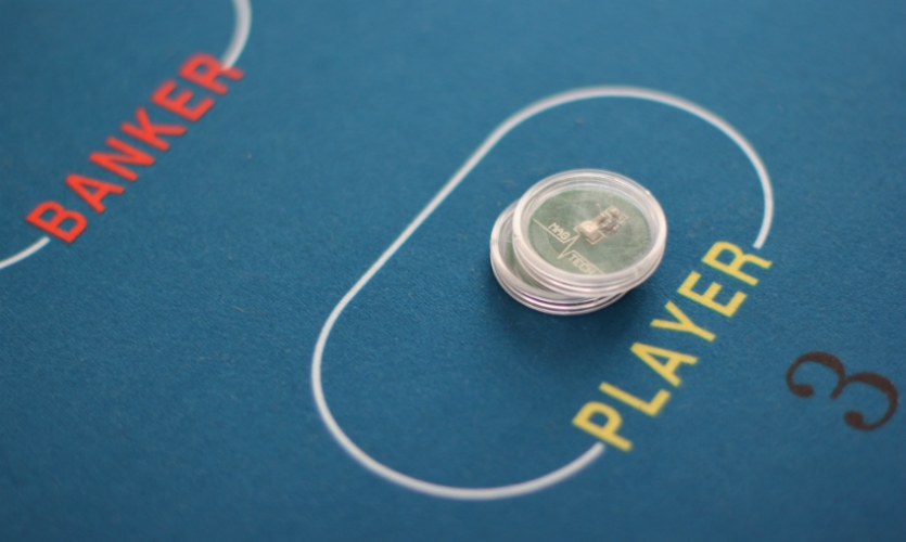 Control Group's digital baccarat table for Walker Digital Table Systems retains the traditional felt table surface and hard plastic chips, but uses embedded RFID and sensor technologies to personalize the game for each user and prevent cheating.
