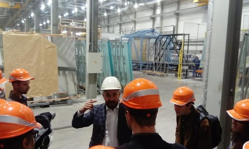 Riga Design Walk participants visit a fabricator warehouse.