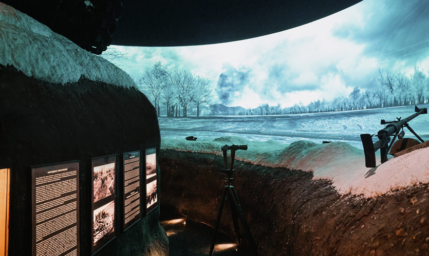 The landscape above the parapet comes to life on a huge wraparound 120-degree screen as German tanks start to approach quickly towards visitors.