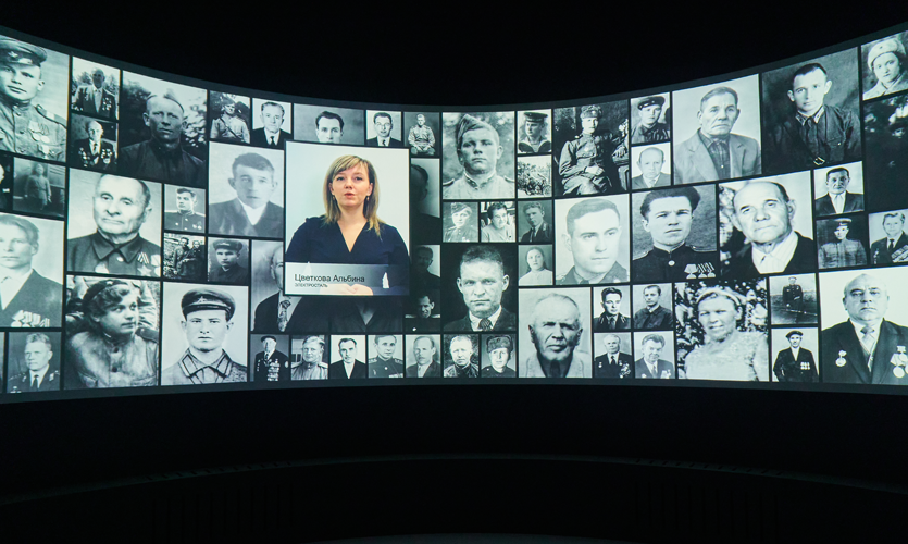 In the Immortal Regiment hall, visitors are invited to honor war heroes: hundreds of personal stories are shown on the huge screen covering the wall of this space.