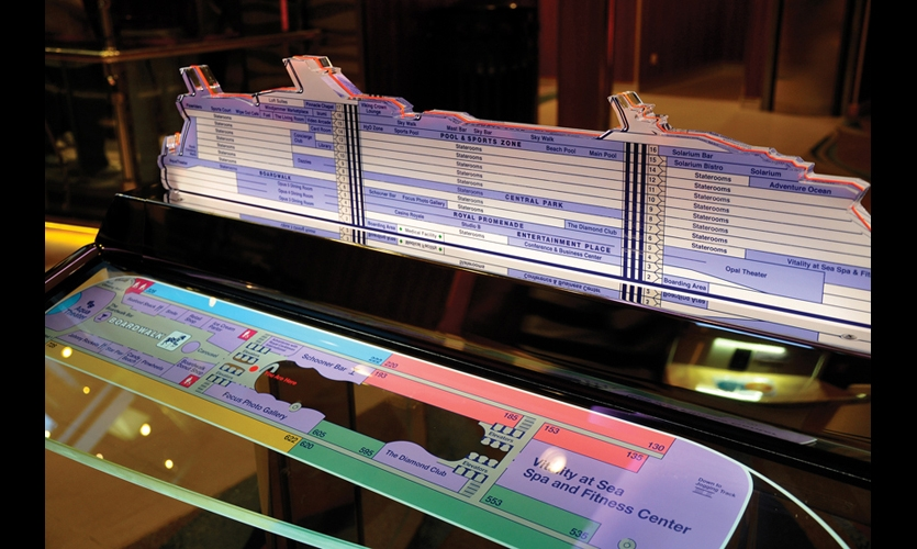 There are eight of the freestanding glass-and-steel directories, which show the ship's overall layout and individual deck plans. They are abbreviated versions of wall-mounted directories in the elevator lobbies.