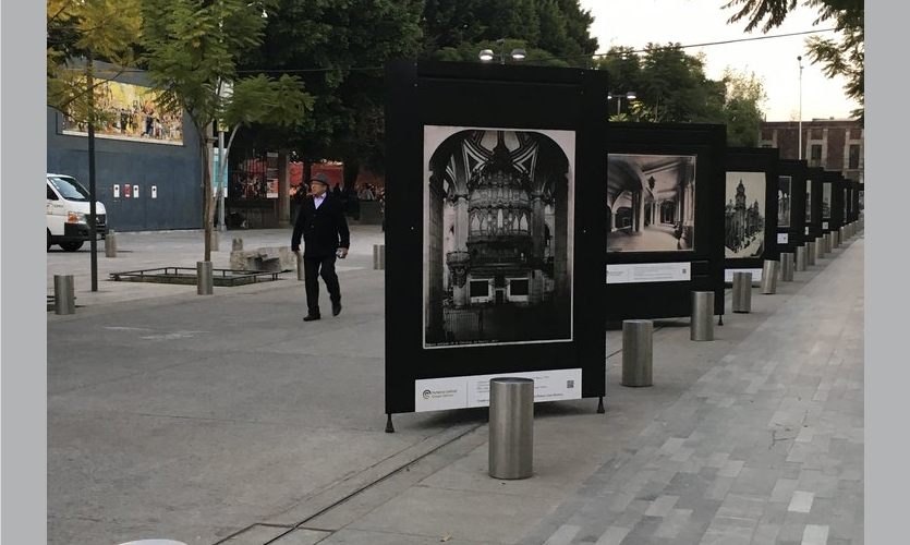 An outdoor photography exhibition: The second with panels to the ground, with built in slots above and below intended to hold a text panel, in either location.