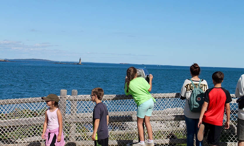 Children sightseeing from the Portland Head Light.