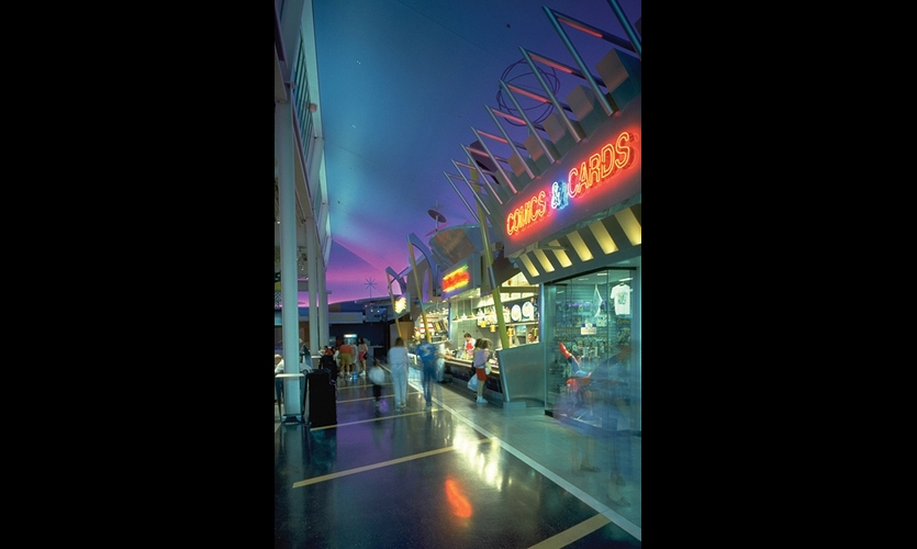 At Gurnee Mills, the architecture was in the background, behind graphic storefronts, flying indoor billboards, pop art sculptures, floor-to-ceiling thematic layers, and eyefuls of color, image, and typography.