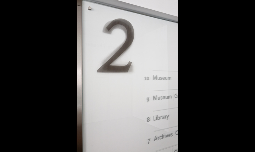 Skyline Design etched floor numbers and major rooms in glass and rubbed them with color to indicate floor numbers.