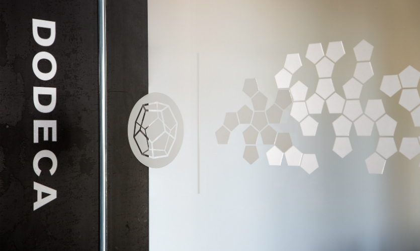 The Platonic solids play out as room names and as graphic forms for distraction banding on conference rooms. (Photo: Gabriel Branbury)