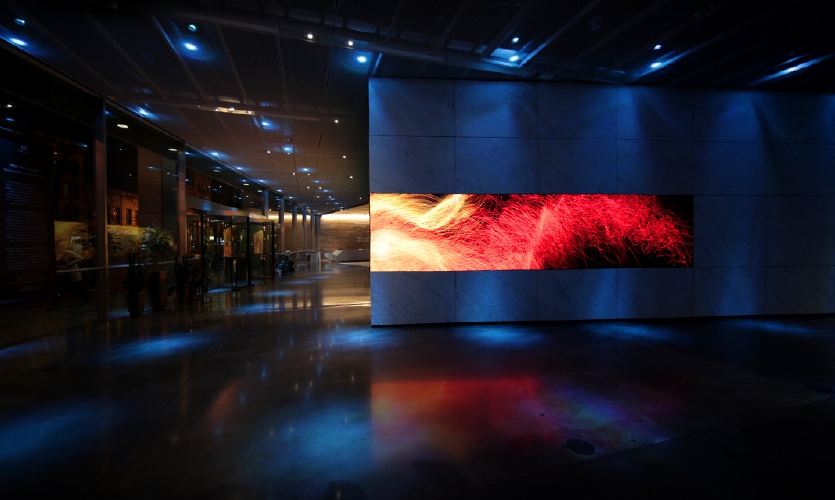 The Dolby Gallery setup includes a built-in Orchid 1.9 mm pixel pitch, 62-foot-long, L-shaped SiliconCore LED display and 52-channel surround-sound Dolby Atmos audio system.