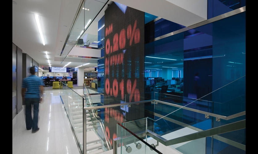 Large-scale digital displays animate the staggered stairways of the Dow Jones/Wall Street Journal offices and reflect the fast pace of the news industry. (Photo: ©Albert Vecerka/Esto)