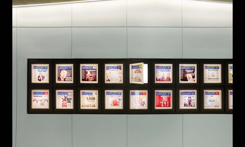 In the Barron's corridor, the weekly magazine's covers are arranged in 52 illuminated niches fronted by acrylic doors so employees can update them. Xibitz ensured the covers were evenly lit by using an LED system to flood the cavities of the display case. (Photo: Jeffrey Kilmer)