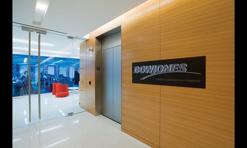 Design360 used the Helvetica Neue of the Dow Jones logo as the foundation font for signage throughout the 270,000-sq.-ft. offices. Against a blued steel backplate, the logo for the main identity sign is rendered in push-through acrylic with sandblasted steel faces. (Photo: Jeffrey Kilmer)