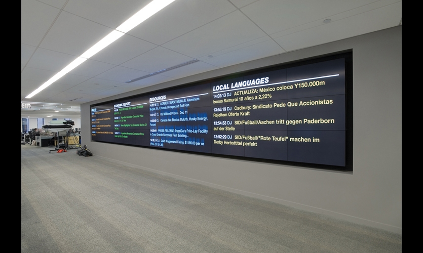 Outside the newsroom, a series of video cubes gives the Dow Jones newswires team access to top stories minute by minute as they are sent from various news agencies. (Photo: Jeffrey Kilmer)