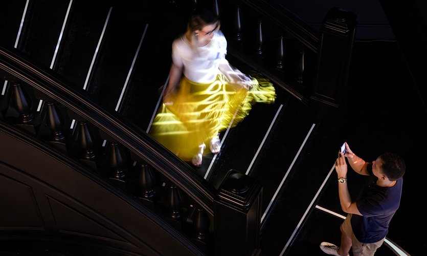 This interactive experience on the stairs works for groups of up to four guests and is inspired by early fashion shows were held in private homes and models would descend staircases. Photo credit: Sean Airhart/NBBJ
