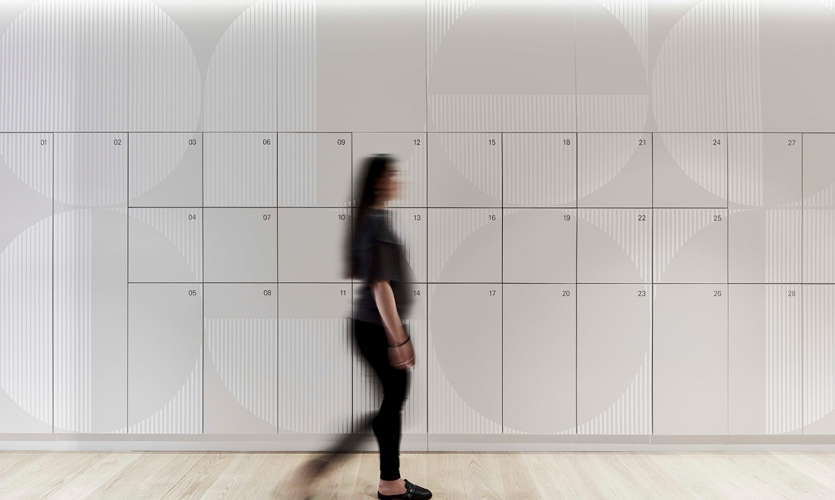 Graphic patterning was used to animate locker banks and circulation spaces.