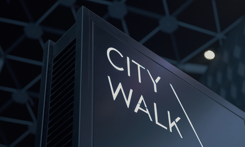 City Walk lit signage welcomes visitors into this spectacle after sunset.