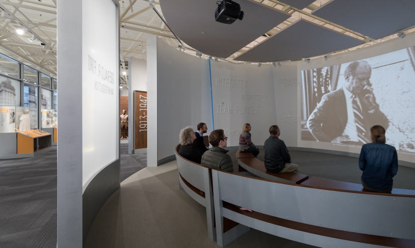 The experience begins when visitors are initially drawn into the centrally-located orientation theater, which is surrounded by a high-level interactive timeline.