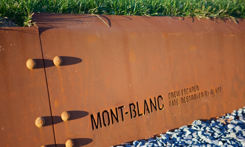The team chose riveted weathering steel for its longevity and as an allusion to the visual language of shipbuilding.