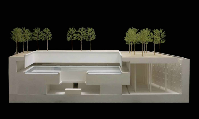 (2007) This early architectural model shows the original scheme with the names commemoration below. The retaining wall at the plaza level, in this model, is where the commemoration is located today, while the underground viewing hallways were eliminated due to security and cost.