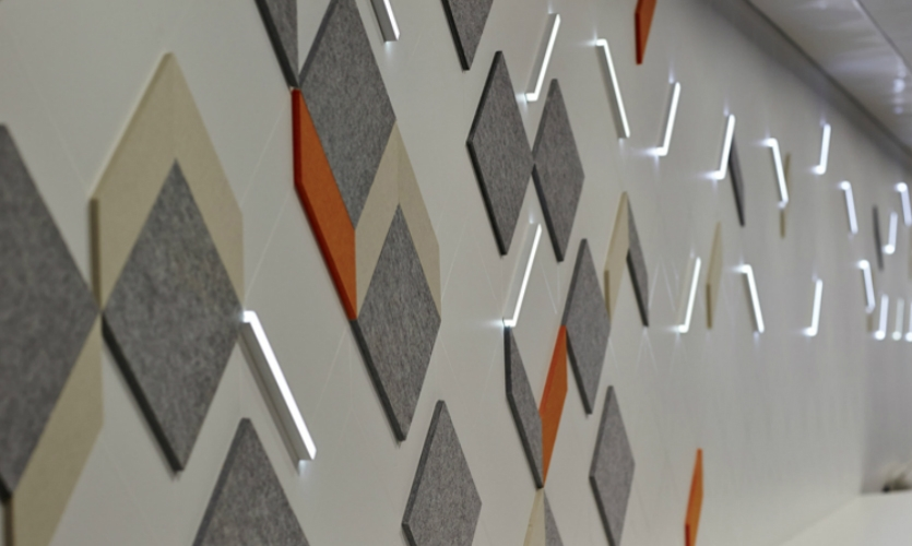 The team deconstructed the logo and used a wide range of materials and techniques to enliven the workplace.