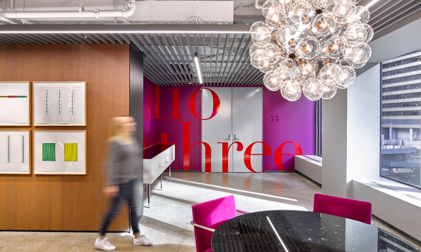 Walls adjacent to meeting rooms also received colorful typographic treatments.
