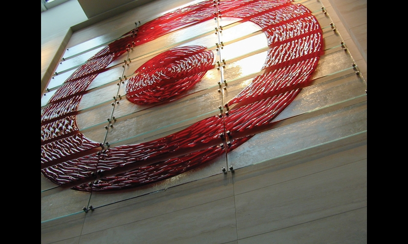 GlassArt Design rendered the Target logo in a 136-in.-square piece consisting of 27 kiln-formed glass panels with fused color and stainless steel hardware.