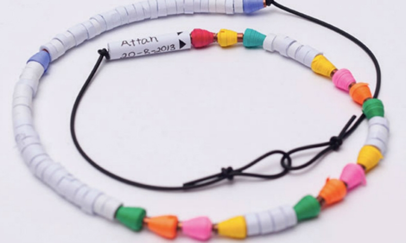 Responding to the Gates Foundation's challenge to redesign the global childhood medical record, Greater Good created a two-part system: a paper record and a necklace with beads for vaccinations given and still needed.