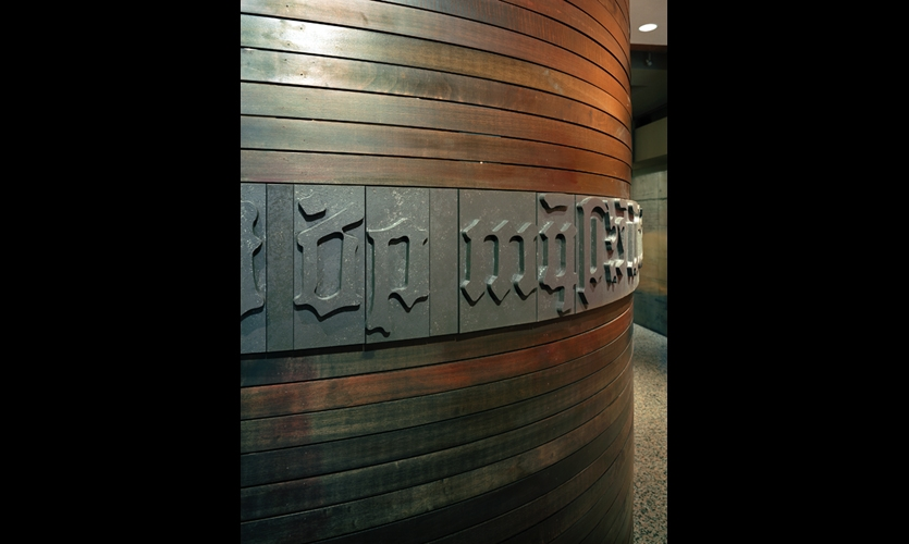 The exhibit is identified with raised-letter blocks that resemble pieces of movable type.