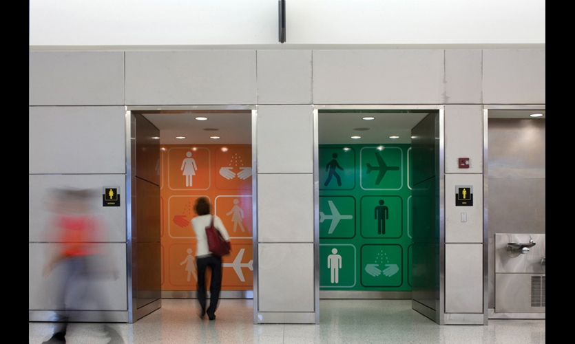 Bold graphics make the bathrooms easier to spot and add hits of color to an otherwise neutral airport environment. (Photo: Nic Lehoux)