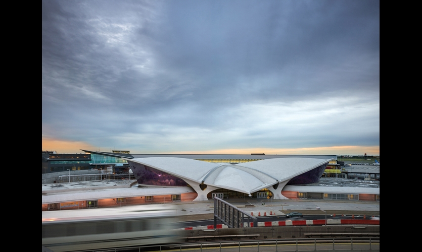 The new JetBlue terminal is literally in the shadow of Eero Saarinen's iconic TWA Terminal next door. (Photo: Prakesh Patel)